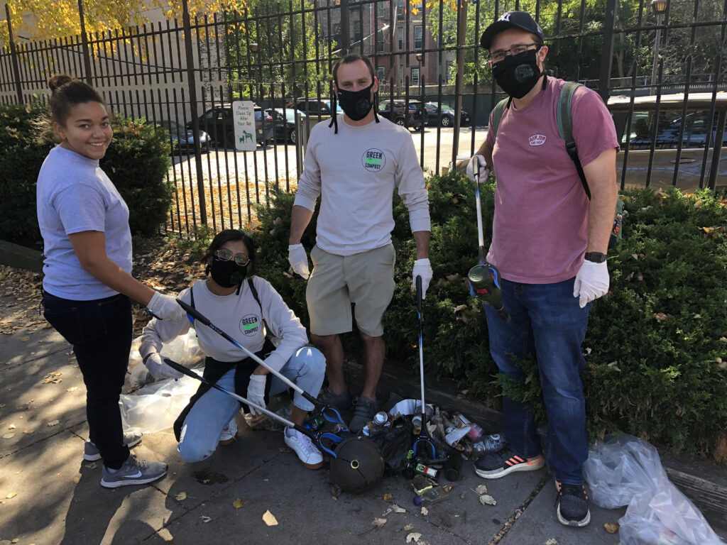 The Green Bucket Compost team cleaning up the sidewalk of trash