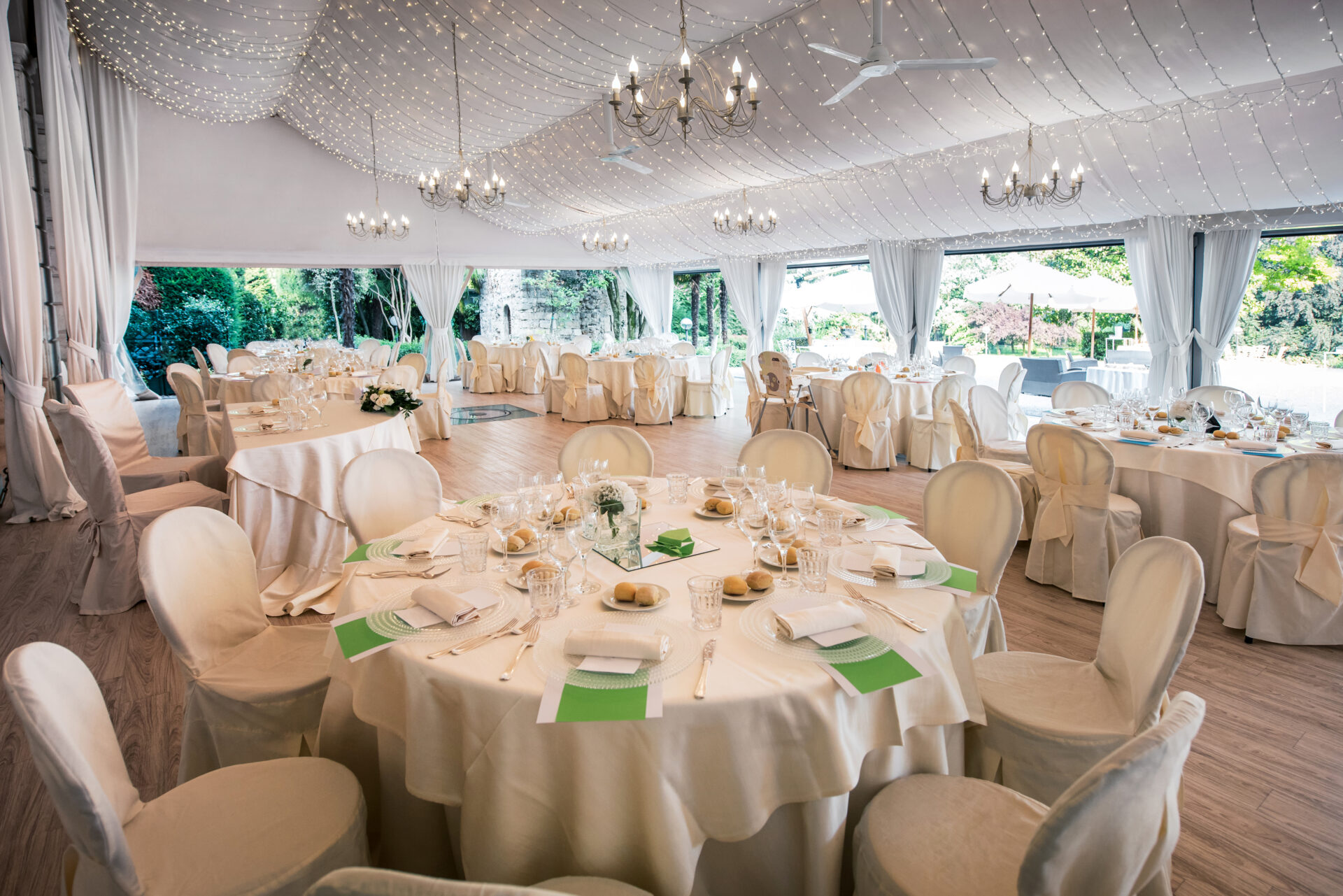 Tables and chairs set at a wedding venue